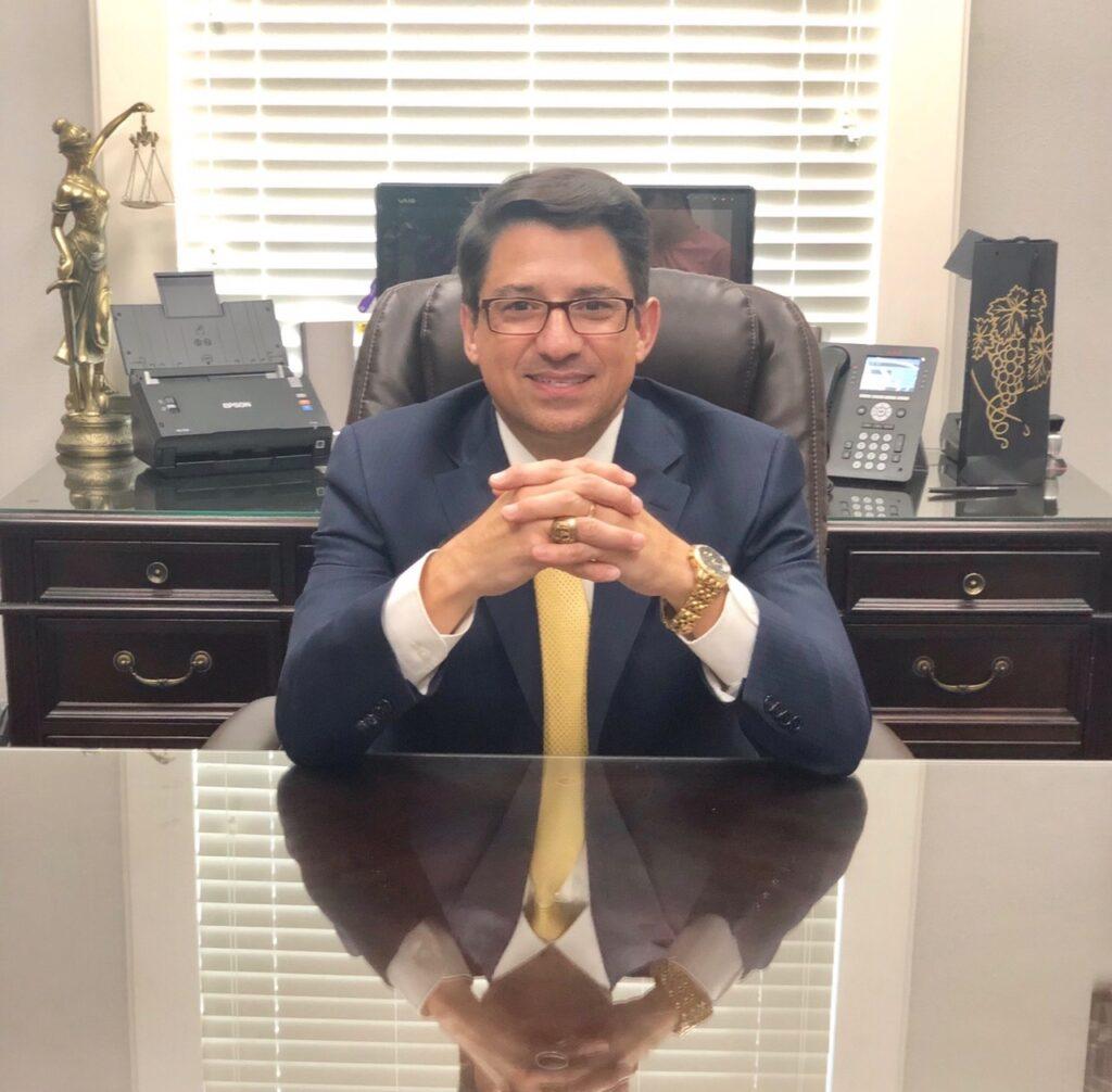 Oscar A. Vela sitting down